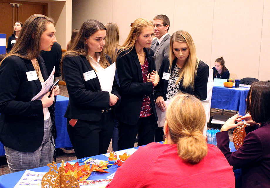 Alumni job seekers at a career fair