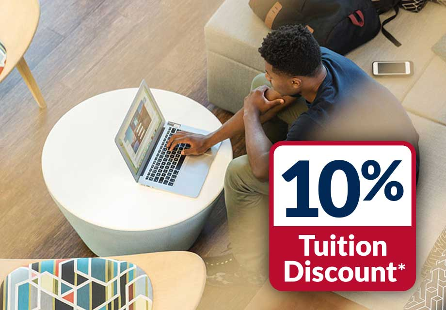 10% Tuition Discount Logo and Man on Computer