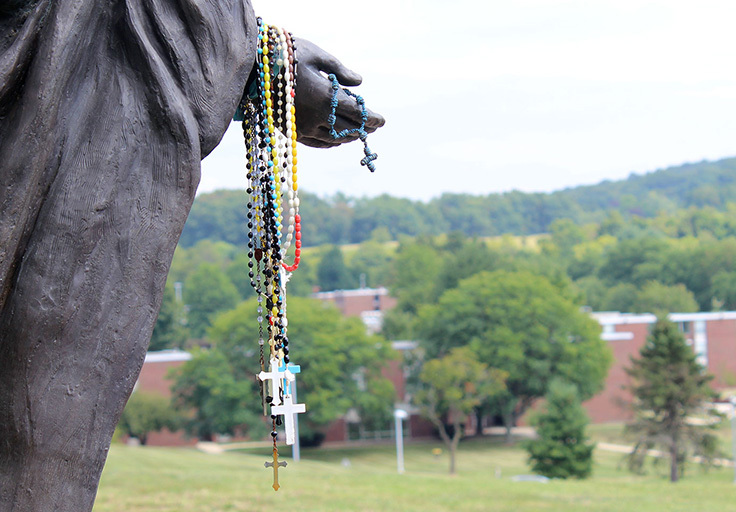 rosaries at the Mary statue