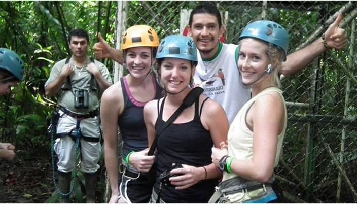 people in zip-line gear