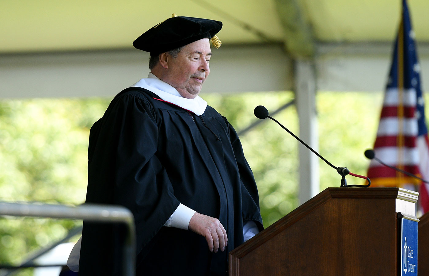Paul Meiklejohn giving commencement speech