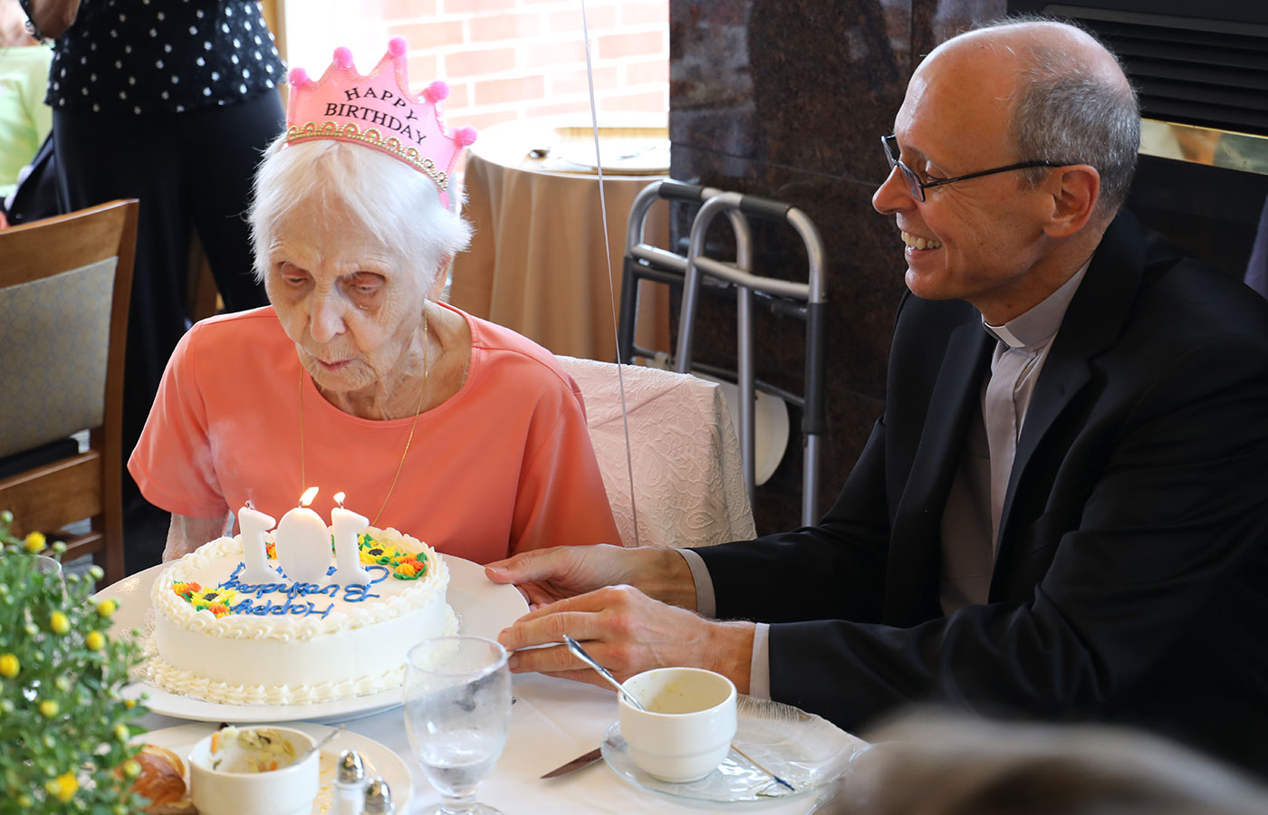 Dr Caroline Hallshwandner and Father Jim celebrating Carolines 101st birthday
