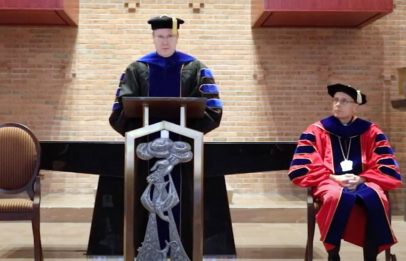 Brother Dan awarding medals during 2020 commencement