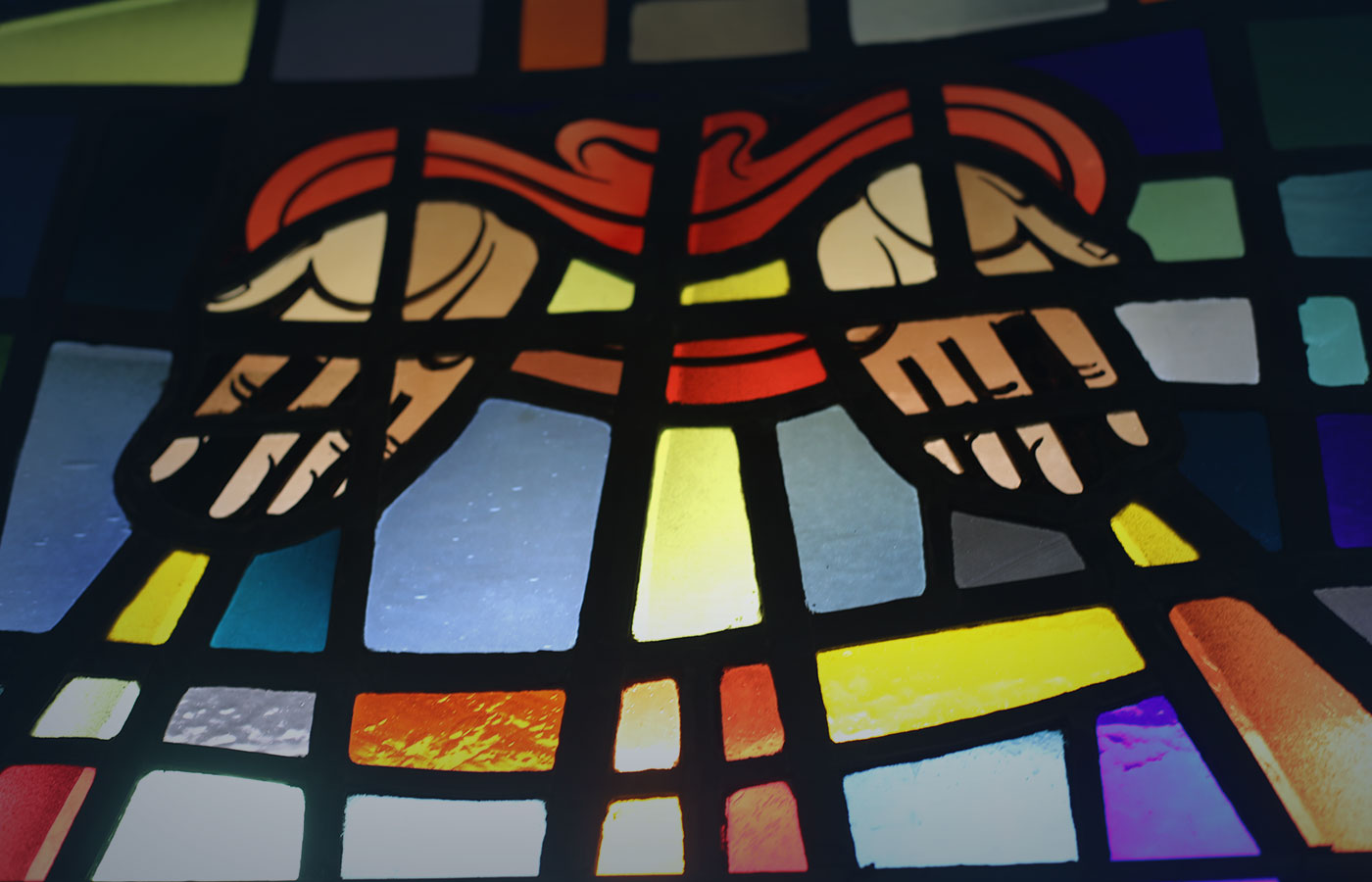 Hands in Prayer Stained Glass at Connelly Chapel