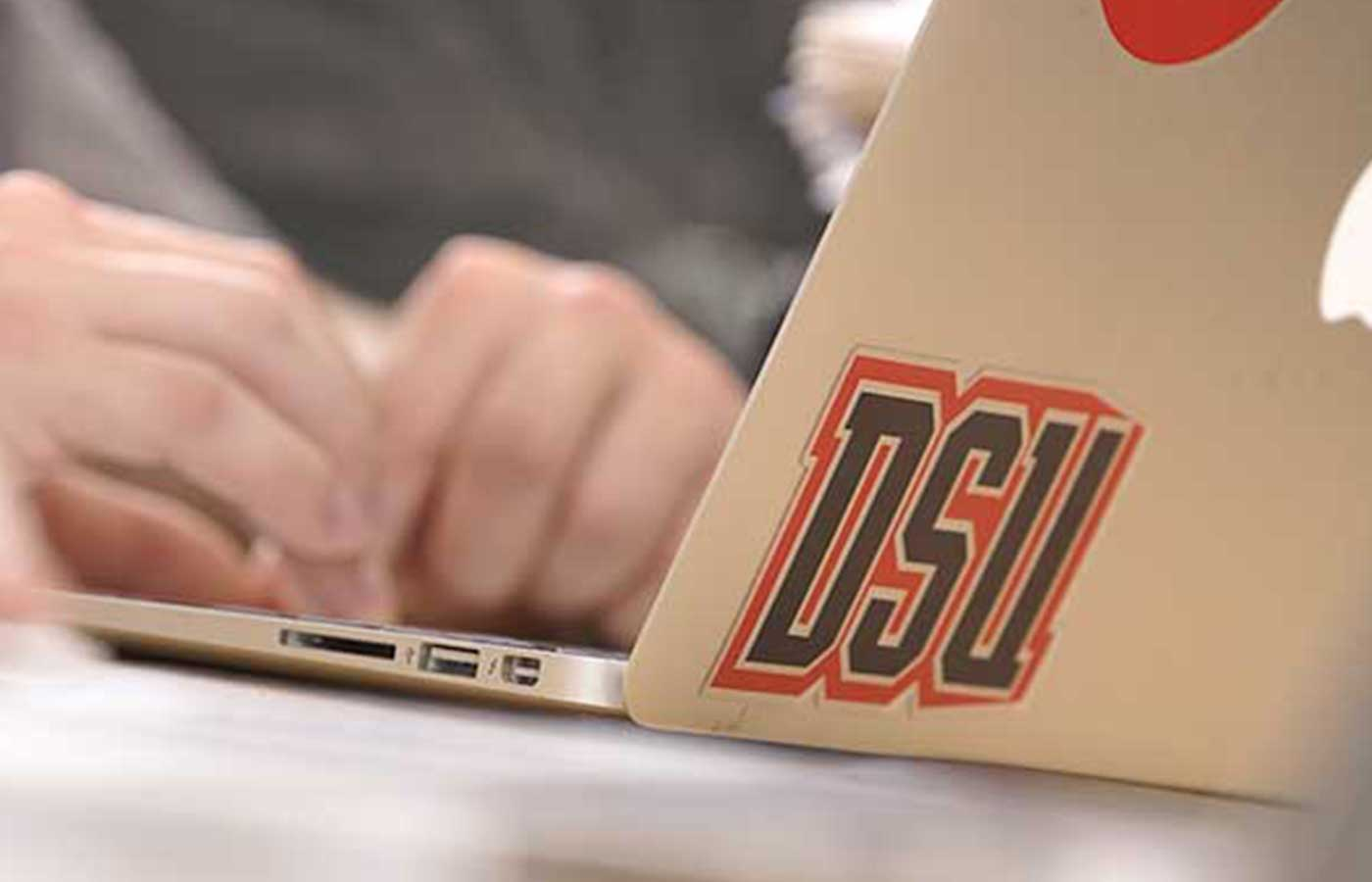 Laptop with DeSales University Sticker